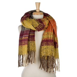 """Soft, heavyweight, open scarf with a tweed pattern and fringe on the ends. 100% acrylic. Measures 24"""" x 72"""" in size."""