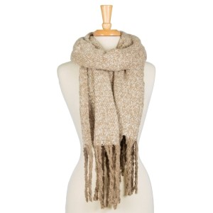 "Super soft, knit, open scarf with a two tone design and tassels along the edges. 100% polyester. Measures 20"" x 72"" in size."
