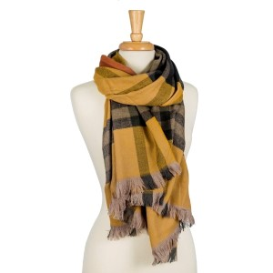 """Heavyweight, oversized, plaid open scarf with frayed edges. 100% acrylic. Measures 26"""" x 78"""" in size."""