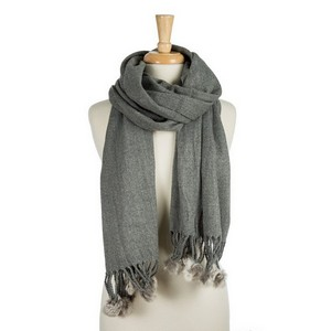 """Heavyweight, knit scarf with tassels and faux fur pom poms on the ends. 100% acrylic. Measures 26"""" x 72"""" in size."""