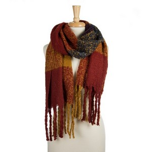 "Super soft, heavyweight, open scarf with a plaid pattern and tassels on the ends. 100% polyester. Measures 20"" x 72"" in size."