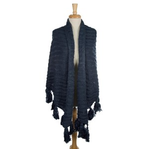 Heavyweight, knit cape with pom poms along the bottom edge. 100% acrylic. One size fits most.