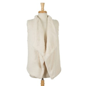 Ivory, faux fur sleeveless vest. One size fits most. 100% polyester.