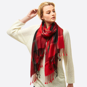 """Lightweight, open scarf with a plaid print and frayed edges. 100% viscose. Measures 27"""" x 72"""" in size."""
