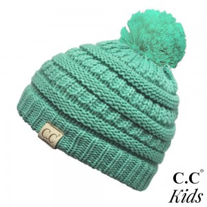 "C.C Kids Exclusive Pom Pom Beanie. 100% acrylic. Measures 7"" in diameter and 8"" in length.  Approximate fit: 4 to 7 years of age."