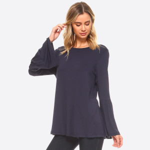 This solid top is designed with long sleeves featuring a split bell cuff for a stylish throwback look.   • Round Neckline  • Long bell sleeves  • Relaxed Fit Through Body  • Straight Hem  • Soft, Medium-Weight Jersey  • Closure Style: Pullover  • Import   Care: Hand Wash Cold. Tumble Dry. Iron Low. Do not dry Clean.   Content: 95% Rayon 5% Spandex   Pack Breakdown: 6pcs/pack. 2S: 2M: 2L