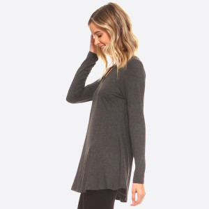 Long Sleeve Crew-Neckline Tunic • Lightweight jersey tunic.  • Crew neckline.  • Long sleeves.  • Relaxed silhouette.  • Pullover style.  • Rayon/spandex.  • Imported   Composition: 95% Rayon, 5% Spandex  Pack Breakdown: 6pcs/pack. 2S: 2M: 2L