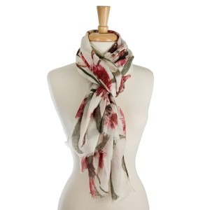"Lightweight scarf with a washed out floral print and metallic gold accents. 100% polyester. Measures 36"" x 72"" in size."