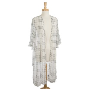 Lightweight, plaid print kimono with ruffled sleeves. 100% polyester. One size fits most.