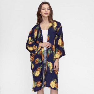 Lightweight, long kimono with a pineapple print. 100% viscose. One size fits most.