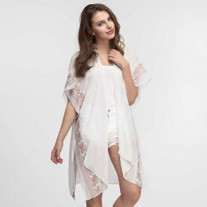 Lightweight, short sleeve kimono with floral embroidery down the sides. 80% polyester and 20% viscose. One size fits most.