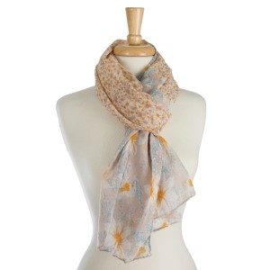 "Lightweight, open scarf with a floral print. 100% polyester. Measures 36"" x 72"" in size."