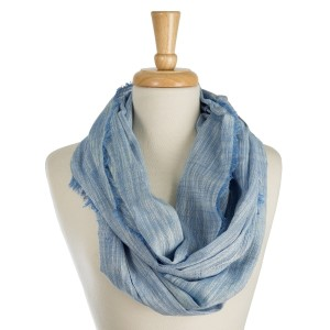 "Lightweight, solid infinity scarf with a stitched line pattern and frayed edges. 100% cotton. Measures 20"" x 38"" in size."