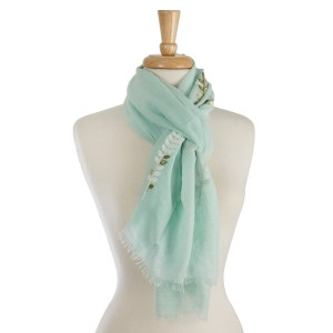 "Lightweight, open scarf with embroidery along the bottom. 70% polyester and 30% viscose. Measures 28"" x 72"" in length."