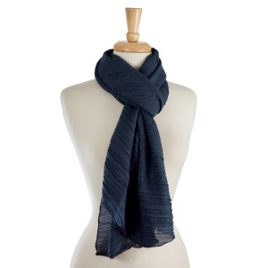 """Lightweight, solid scarf with a ribbed textured. 65% polyester and 35% viscose. Measures 22"""" x 80"""" in size."""
