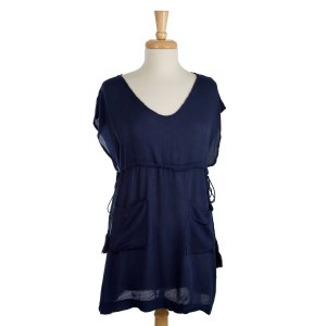 Short sleeve, lightweight top with a light front and two pockets. 100% viscose. One size fits most.