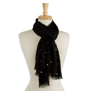 "Lightweight solid scarf with pearl bead and silver tone bead embellishments. 100 % viscose. Measures 28"" x 70"" in size."
