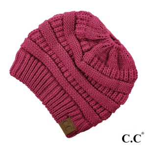 Messy-bun, C.C beanie in hot pink. 100% acrylic.