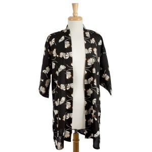 Black short sleeve kimono with apple blossom petals.  100% polyester. One size fits most.