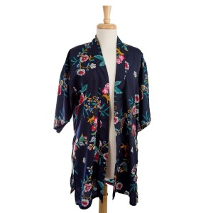 Lightweight, short sleeve, navy blue kimono with a floral print. 100% viscose. One size fits most.