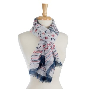 "Lightweight, open scarf with a navy, red, and white anchor print. 100% polyester. Measures 28"" x 70"" in size."