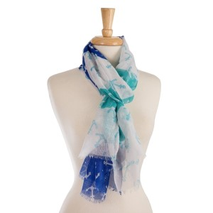 "Lightweight, open scarf with a blue, mint, and white anchor print. 100% polyester. Measures 28"" x 70"" in size."