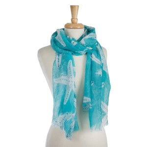 "Lightweight, open scarf with a mint green and white starfish print 100% polyester. Measures 28"" x 70"" in size."