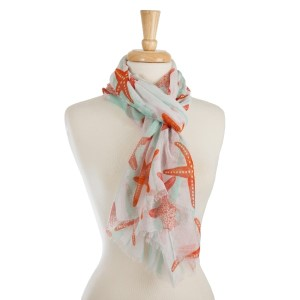 "White, lightweight scarf with a starfish print. 100% polyester. Measures 28"" x 72"" in size."