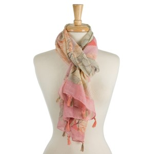 """Lightweight, open scarf with a whimsical print and tassels on the ends. 100% polyester. Measures 27"""" x 72"""" in size."""