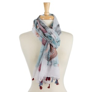 "Lightweight, open scarf with a bohemian circle print and tassels on the ends. 100% polyester. Measures 27"" x 72"" in size."