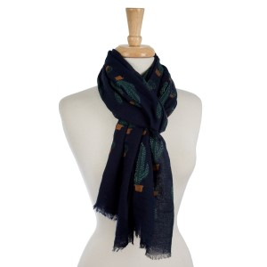 """Lightweight, open scarf with a bohemian circle print and tassels on the ends. 100% polyester. Measures 27"""" x 72"""" in size."""