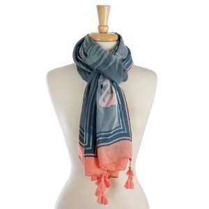 """Lightweight, open scarf with a tropical and flamingo print. 100% polyester. Measures 36"""" x 72"""" in size."""