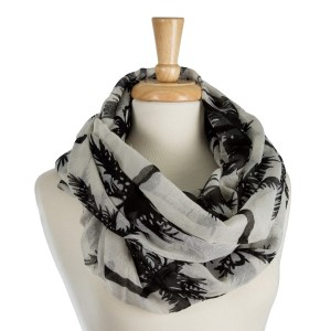 "Lightweight, palm tree printed, infinity scarf. 100% polyester. Measures 36"" x 40"" in size."