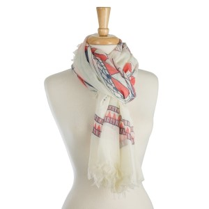 "White, lightweight scarf with an aztec print and frayed edges. 100% polyester. Measures 36"" x 72"" in size."