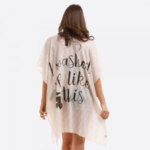 """Lightweight, kimono/swimsuit cover up with """"I washed up like this"""" on the back. 100% viscose. One size fits most."""
