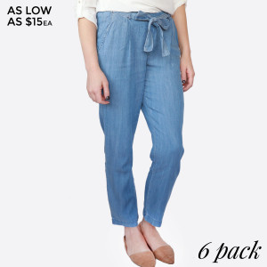 Lightweight, denim pants with two front pockets, an elastic waistband, and a tie front. 70% tencel and 30% rayon. Sold in packs of six - two small, two medium, two large.