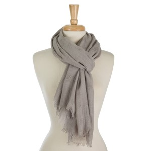 """Lightweight, open scarf with frayed edges. 100% viscose. Measures 31"""" x 70"""" in size."""