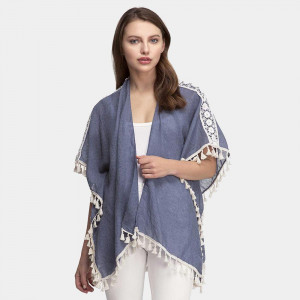 Lightweight, short sleeve kimono with embroidery and tassel accents. 35% viscose and 65% polyester. One size fits most.