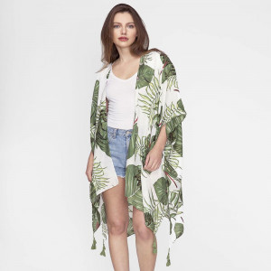 Lightweight, white kimono with a tropical leaf print and tassels on the corners. 100% polyester. One size fits most.