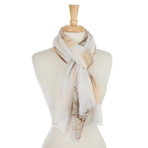 Lightweight, open scarf with a feather print. 100% polyester.