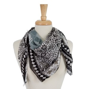 """White square scarf featuring a black and gray print and frayed edges. 100% cotton. Measures approximately 42"""" x 42"""" in size."""