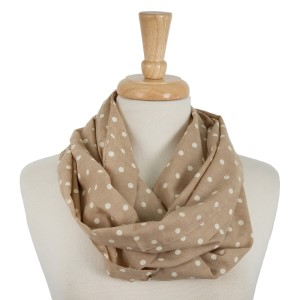 """Lightweight infinity scarf with a polka dot print. 100% polyester. Measures 21"""" x 31"""" in size."""