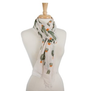 Lightweight, open scarf with a cactus print. 100% polyester.