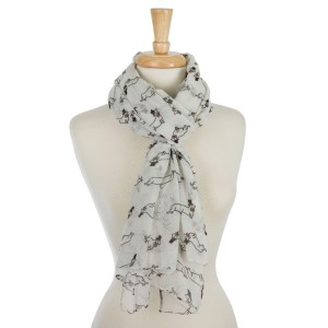 Lightweight, open scarf with a dachshund print. 100% polyester.