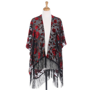Sleeveless vest with a large floral print, burnout velvet accents, and fringe detail. 100% polyester. One size fits most.