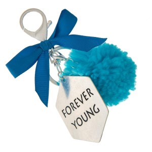 """Silver tone key chain or bag charm stamped with """"Forever Young"""" and a blue pom pom. Approximately 5.5"""" in length."""