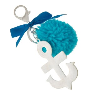 """Silver tone key chain or bag charm stamped with an anchor pendant and a blue pom pom. Approximately 5.5"""" in length."""