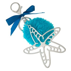 """Silver tone key chain or bag charm stamped with a starfish pendant and a blue pom pom. Approximately 5.5"""" in length."""
