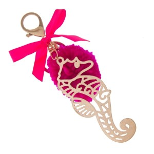 """Gold tone key chain or bag charm stamped with a seahorse pendant and a fuchsia pom pom. Approximately 5.5"""" in length."""