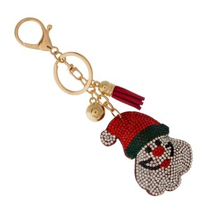 Gold tone keychain and bag charm with a Santa Claus.